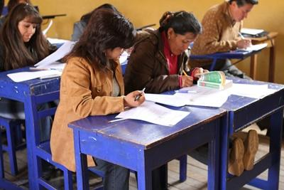 Professional volunteers reviewing material with teachers in training in Peru
